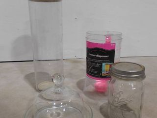 lot of assorted kitchen items including batter dispenser  mason jar  glass dish with dome lid and Tupperware container