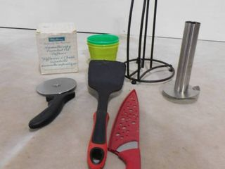 lot of misc  kitchen ware including pizza cutter  paper towel holder  spatula and aromatherapy essential oil diffuser