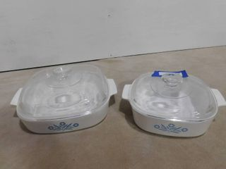 2 matching casserole dishes with lids  one large one small