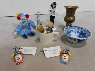 Assorted glass figurines including clowns  a vase and a bowl