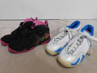 Size 5 5Y black Air Jordan s and size 6Y white 23 Air Jordan s