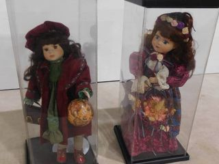 2 porcelain dolls on stands and plastic covers