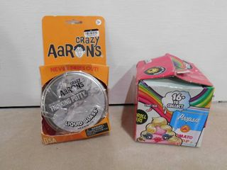 Crazy Aaron s crystal clear thinking putty and Poopsie slime surprise  both packages were opened