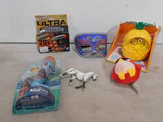 lot of misc  toys including Moana microphone  nerf bullets  masquerade mask and pineapple bubble blowing machine