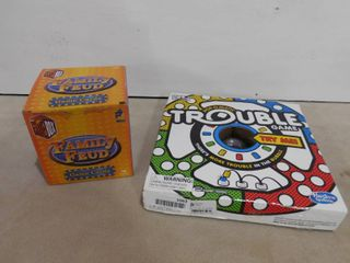 2   board games  trouble  missing player pieces  and family feud game cards