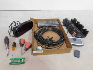 lot of assorted items including an alarm clock  wire  various handle tools and navigation device