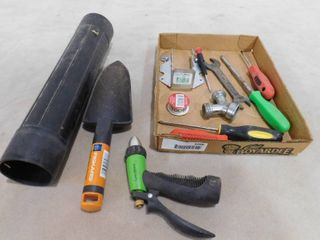 Various hand tools including hose sprayer attachment  garden shovel and various hand tools