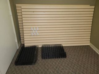 Slat Board Wall Unit Two 48 x 82 x 1 in Panels with 18 Black Wire Shelves 24 x 15 in with 3 in Front lip and 8 White Pegs