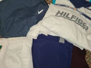 MEN S ClOTHES  PAJAMAS  WORKOUT SHORTS  few T SHIRTS  SIZES are lARGE  There is also a RETRO pair of Shorts even have some Terry Cloth on them