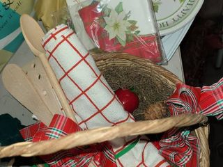 CHRISTMAS DECOR  Basket with wooden Utensils  paper plates   napkins  and other items
