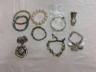 ladies jewelry  seven bracelets  one watch and a scarf holder