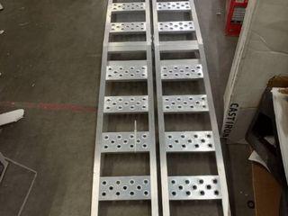 set of foldable aluminum loading ramps roughly 7 1 2 feet long