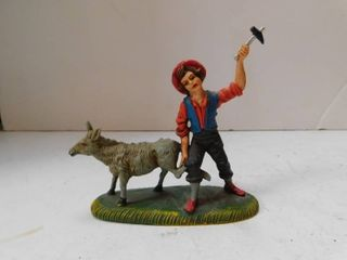 Metal Figurine   Boy Shoeing lamb