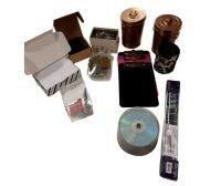 Assortment Box including Envelopes  Straight Pins  Coozie  Door Bell  Mini Clipboards  and 2 Gold Mini Trashcan Containers