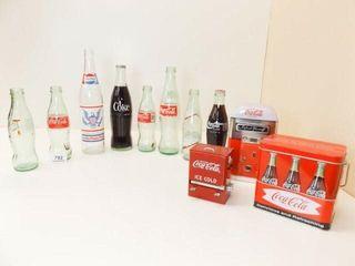 Beverage Bottles  7  Coca Cola Tins  2
