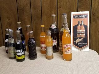 11  Vintage soda bottles and Howdy sign
