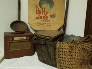 Vintage picnic basket  old radio  mesh bag  cane  grocery bag and wicker ladle