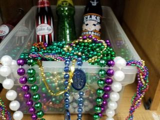 Mardi Gras beads and 3 vintage soda bottles