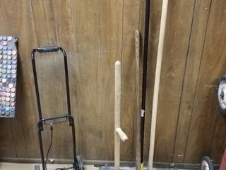 2 push brooms  antique laundry agitator  luggage cart