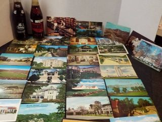 30 post cards and 2 soda bottles