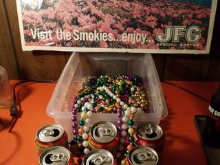 Mardi Gras beads  6 Dr Pepper cans and a coffee sign