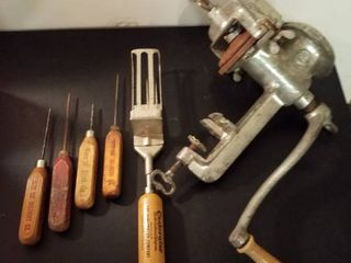 Antique ice picks and a meat grinder