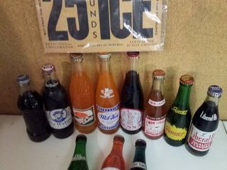 vintage and unusual soda bottles with ice sign