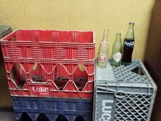 Coke  Pepsi  lucerne plastic crates and 3 soda bottles