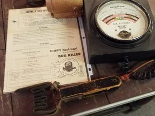 Vintage Goodyear all purpose battery tester and 1956 automatic hari jaric bug killer with paperwork
