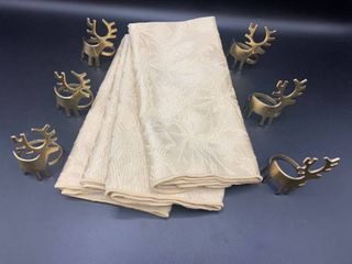 lot of 6 Brass Deer Napkin Rings and 4 Gold Patterned Napkins