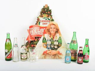 GROUPING OF CANADA DRY BOTTlES   ADVERTISING