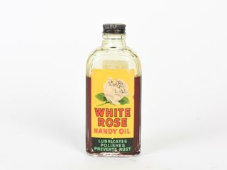 WHITE ROSE HANDY OIl 4 OZ  BOTTlE   SOME CONTENT