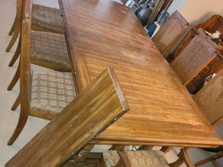 Wood Dining Table 30 x 87 x 42 in with 12 in leaf and 6 Dining Chairs and 2 Captains Chairs Chairs in Need of Repair