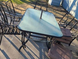 Iron and Glass Patio Table 28 x 66 x 40 in with 6 Chairs and Cushions for 2
