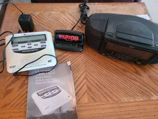 2 alarm clocks and a weather radio