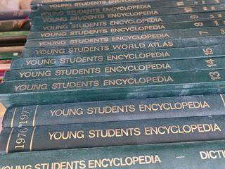Young students encyclopedias