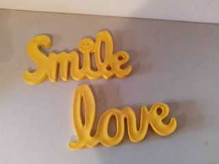 Yellow Script Wall Hangings Depeciting  Smile  and  love
