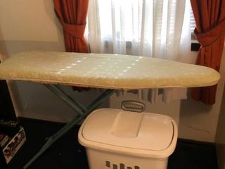 Ironing Board with Multiple covers and Hamper with Wheel location Master Bedroom