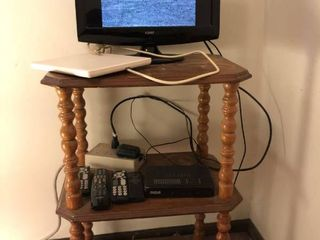 Coby Brand 13a TV and Wooden TV Stand Combo with other Miscellaneous Electronics RCA Brand Antennas Surge Protector and Various Remotes location Spare Bedroom Two