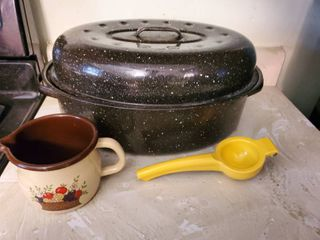 lot of 3  Enamel Roasting Pan and Enamel Cute Creamer Dish with Fruit Design and Yellow Hand Held Juicer