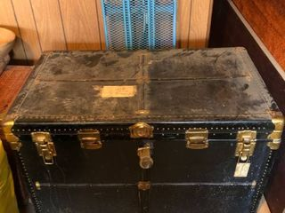 Vintage Wooden and leather Trunk with Brass locks and Handles with Fabric Inside Trunk location Garage