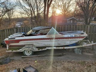 Red and White Ozark Boat with Ozark Trailer    5 lugs for Tire    Must Bring own Means for Removal