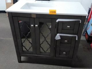 vanity with top brown mirrored doors small chips on top and crack