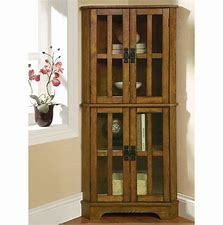 Coaster Company Warm Brown Oak 4 shelf Corner Curio Cabinet  Retail 259 49