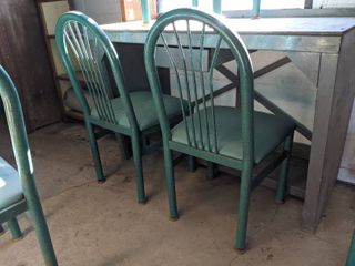 7  Green Cushioned Chairs