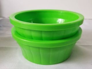 lot of Two Green Kaytee Food Dishes