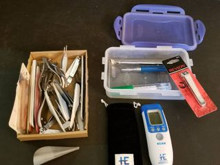 Assorted toenail and fingernail clippers and tweezers