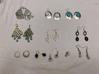 Set of ten pierced earrings and two rings