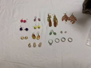 Set of ten pierced earrings  four rings and three pearl pendants