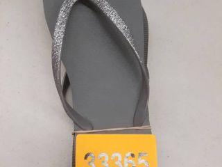 Grey flip flops size unknown